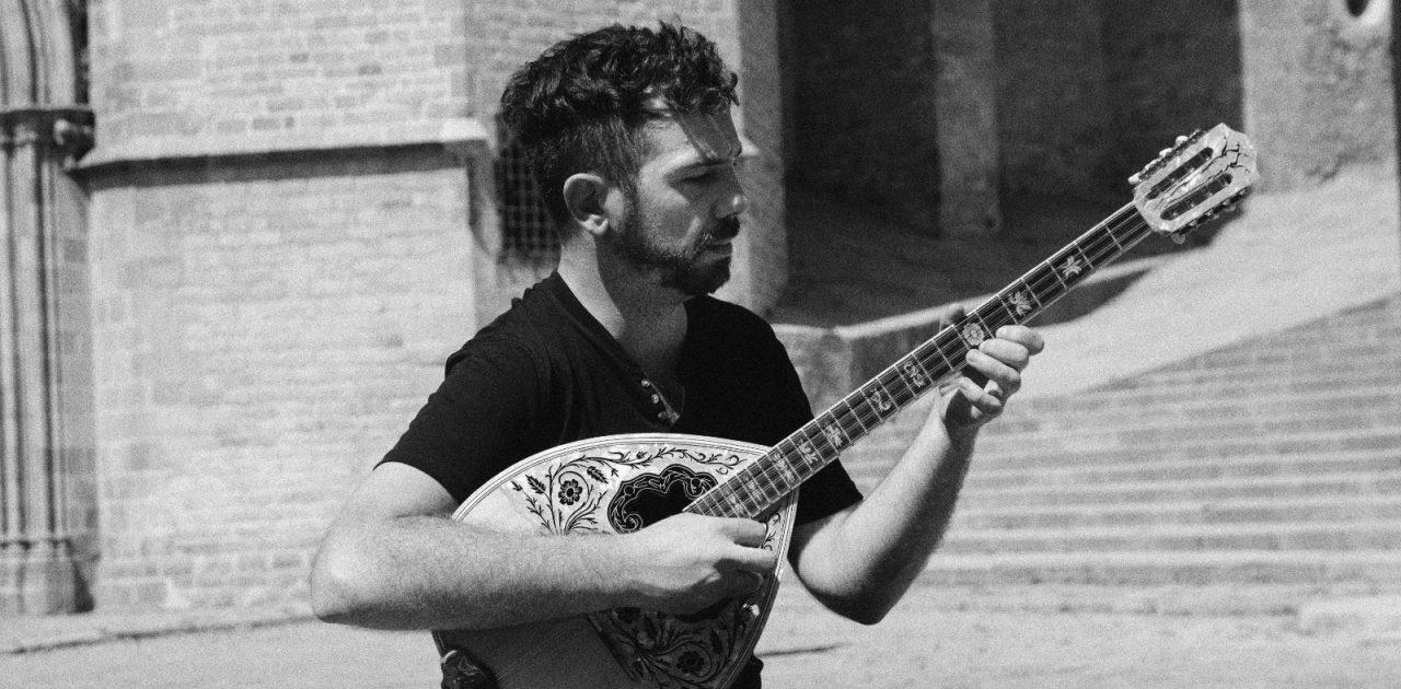 man playing bouzouki